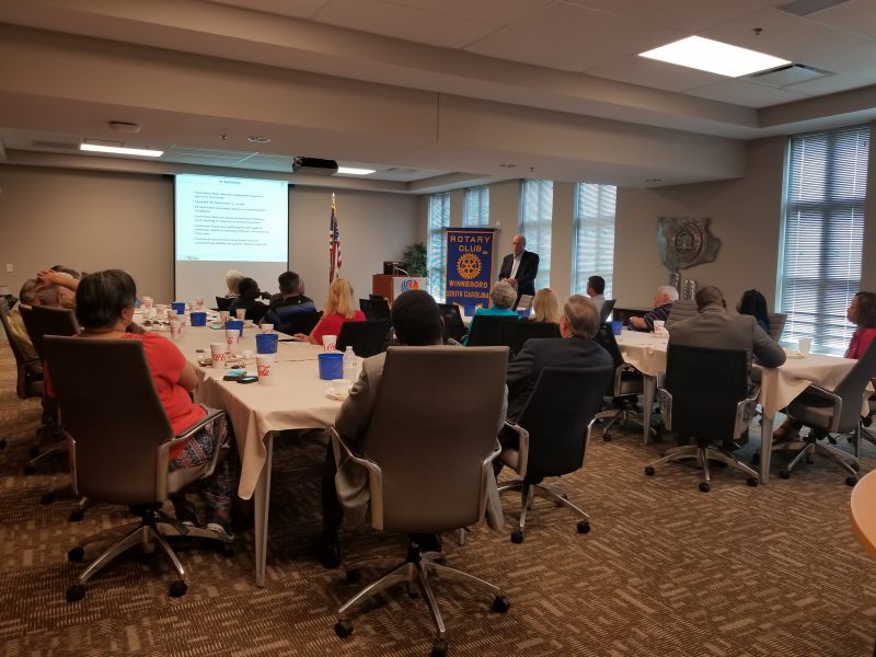 Rotary members & guests receiving an SCANA update from Jim Landreth, Senior VP for SCANA on August 21, 2018